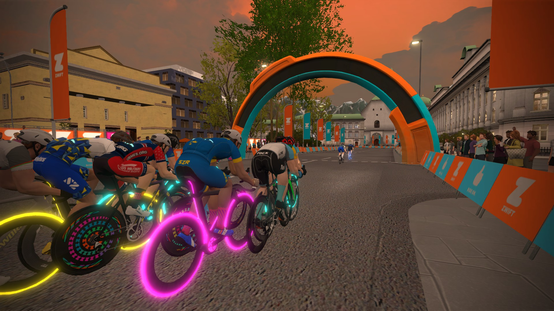 Zwift cyclists racing for an arch