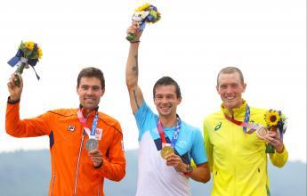 Rohan Dennis wins gutsy bronze in road cycling